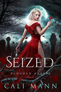 Seized: A Vampire Reverse Harem Romance